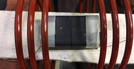 Preheating steel laminate parts with induction