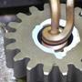 Shrink fit a steel gear onto a steel gear motor shaft